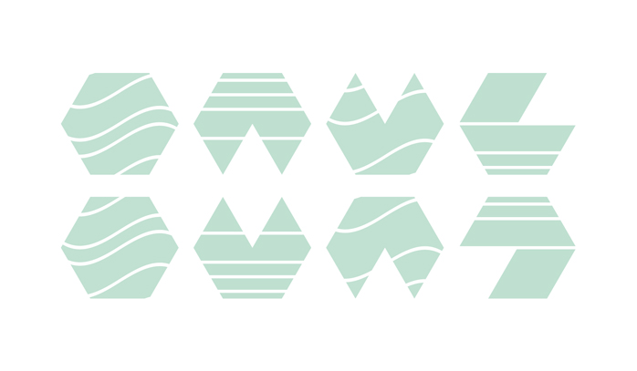 Figure 1: Template hex designs, each printed in a translucent green ink. Hexes in the bottom row are rotated versions of hexes in the top row. There are two density levels: one for ink and one for blank paper.
